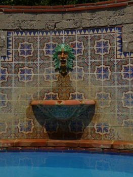 Tile fountain with Green Man face