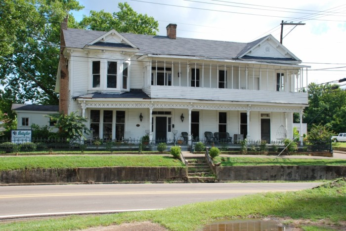 This old stagecoach inn on Depot Street was built before the railroad came through. It started out as a regular ol' I-house around the 1860 and then just grew and grew over the years into what we see today.