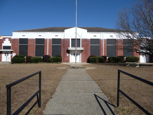 The center section of the building is the auditorium, with entrances to the two main hallways to either side.
