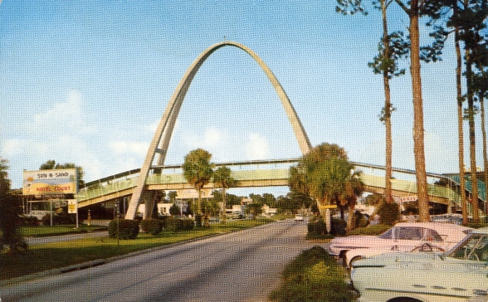 Sun 'n Sand Hotel Court . . .showing the picturesque overpass spanning U.S. Highway 90. Located between Gulfport and Biloxi, Mississippi.
