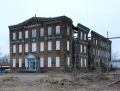 Corinth Machinery Building, photo Jan 2010, showing 2 collapsed wall sections