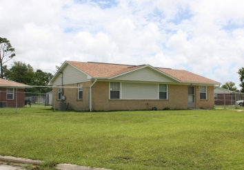 House at intersection of Holly Circle and Walnut Court, Forest Heights Subdivision. Gulfport Miss. Image made by author 7-22-2012