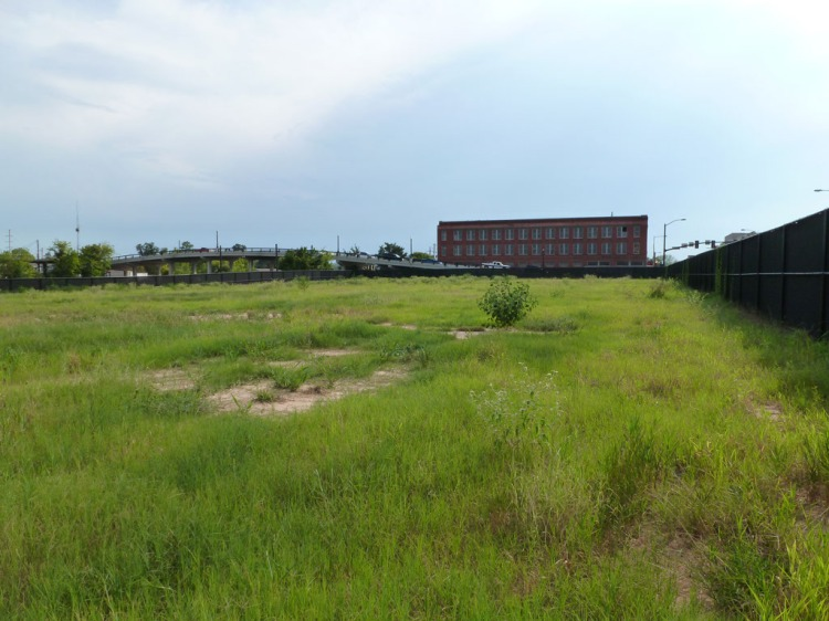 For kicks, I checked in on the grassy lot that held the Meridian Hotel until last year. Here's how it looked as of August 2012. I'm sure that arts and entertainment center is just about to get underway, any minute now.