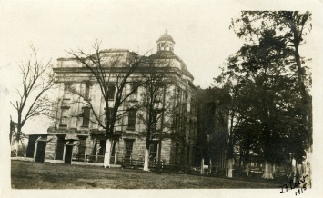 """T.F. Laist, 1915. North side of Old Capitol Building, sign in front says """"Danger Keep Out."""" MDAH Accession PI/STR/C36 /Box 20 Folder 95"""