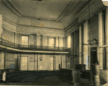 T. F. Laist, 1915. House of Representatives. Interior of Old Capitol Building, photo shows dilapidated condition, pieces of broken plaster and rubble on floor, Corinthian columns, railings, balcony. MDAH Accession PI/STR/C36 /Box 20 Folder 95