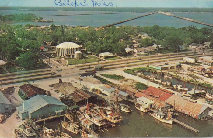 The picturesque eastern top of the Biloxi peninsula lies between Back Bay Biloxi and the Gulf of Mexico. Shrimp and oyster boats dock before beautiful St. Michael's Church which echoes the sea in its shell-like dome and the fish-and-nets motif of its stained glass windows. Biloxi, Miss.