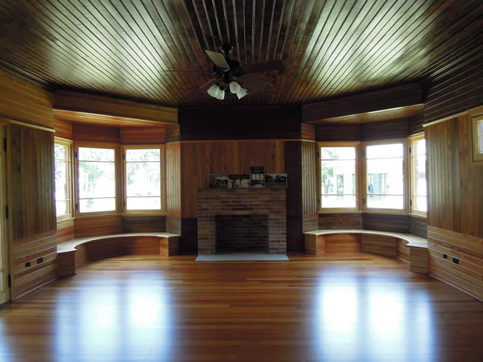 The Charnley-Norwood House is in a bungalow style built in a T-shape. The west bedroom shows how the generous window seats and windows bring in natural light which emphasizes the unique curly pine walls and ceiling. (Photo by Susan Ruddiman/Mississippi Heritage Trust)