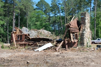 The former Philadelphia Library log cabin after a tornado ripped through Northside Park in 2011. Photo May 4, 2011, by Jennifer Baughn, courtesy MDAH Historic Resources Database.