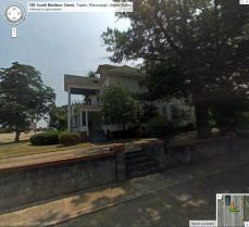 West Elevation Spain House Tupelo, Lee County. from Google StreetView July 2008 accessed 10-14-2013
