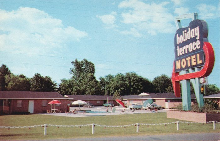 holiday terrace MOTEL. Highway 80 West, 1 1/2 Miles. Phone FLeetwood 2-5011 Teletype JN-81. Jackson, Mississippi. Air-Conditioned--Room Telephones--Television--Swimming Pool--Johnny's Restaurant on Property. Master Host. AAA.