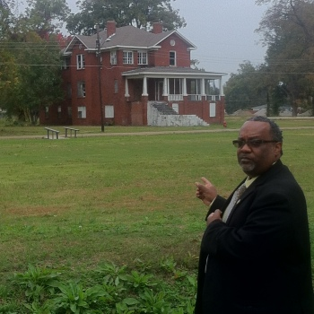 Mayor Darrell Johnson of Mound Bayou points the way to the Isaiah T. Montgomery House.