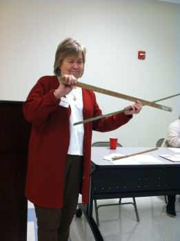 Betty Shaw, president of the Historical Society of Gulfport, show off her yardstick collection at a recent meeting.