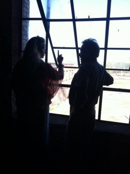 Erica Speed and Bruce Smith admire a restored window at the J.J. Rogers Building