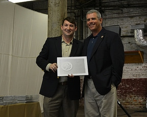 MHT President Brad Reeves presents Speaker of the House Philip Gunn with the Libby Aydelott Award for Outstanding Achievement in Public Policy for his championship of the state historic tax credit at the Heritage Awards Luncheon on June 10 in Tupelo.