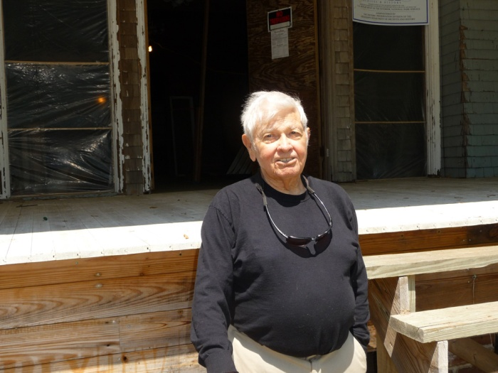 E. Louis Malvaney in front of the unfinished Charnley-Norwood House, April 2012.