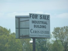 Keep trying, maybe someone will buy the industrial building before this sign gets too faded.