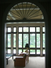This fan-topped aperture graces the transit between Tranquility's foyer and sunroom.