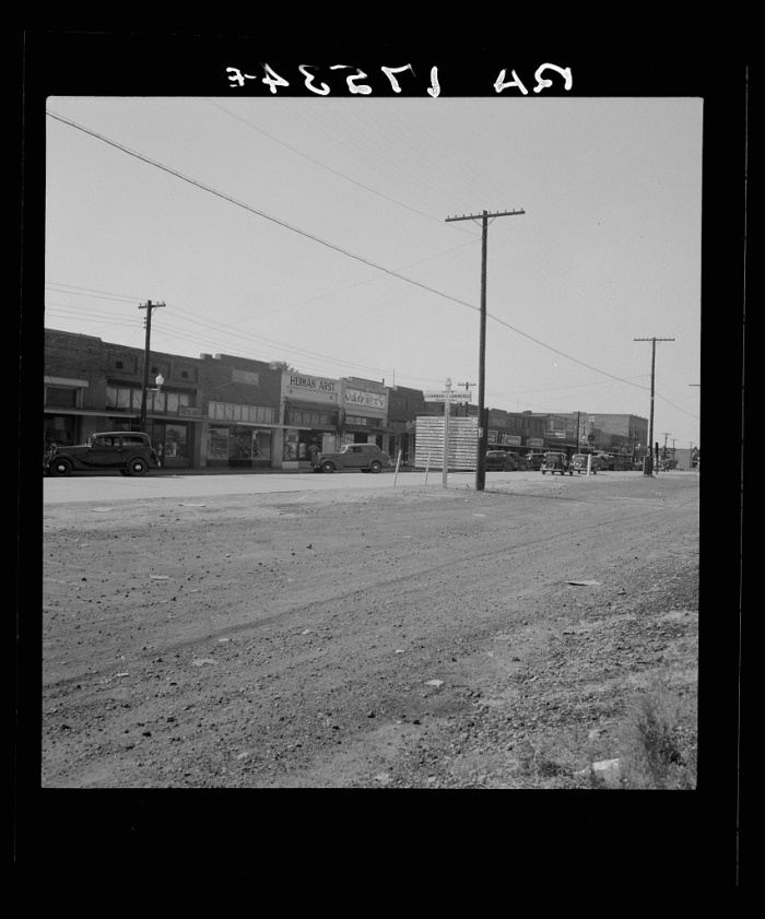 Main street. Drew, Mississippi. Dorothea Lange, photographer. Date Created: 1937 June-July. Medium: 1 negative : nitrate ; 2 1/4 x 2 1/4 inches or smaller.