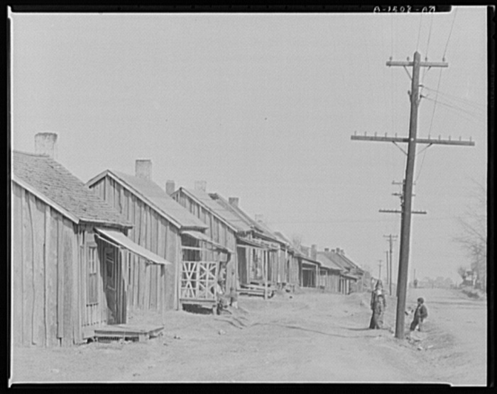 Street in Negro quarter. Tupelo, Mississippi. Walker Evans (1903-1975), photographer. Date Created: 1936 Mar. Medium: 1 negative : nitrate ; 8 x 10 inches or smaller.