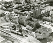 """Item Number: 1     Image Date: 195- Creator: Hiatt Photo Service. Description: """"Old Capitol, War Memorial Building."""" Aerial photograph shows east side of downtown Jackson with State St., Capitol St. and commercial buildings.  City: Jackson. County: Hi Box Number: 476    Folder Number: 2"""