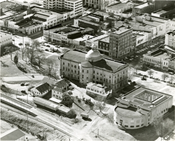 "Item Number: 1     Image Date: 195- Creator: Hiatt Photo Service. Description: ""Old Capitol, War Memorial Building."" Aerial photograph shows east side of downtown Jackson with State St., Capitol St. and commercial buildings.  City: Jackson. County: Hi Box Number: 476    Folder Number: 2"