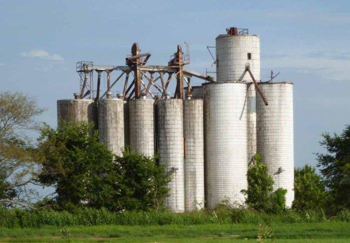 Concrete silos next to railroad tracks north of Sledge, Quitman County