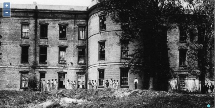 This remarkable photo in the MDAH Daniels collection shows convicts at the back of the Old Capitol. It was probably taken after April 1916 and shows convicts engaged in the labor that the Legislature had directed in their bill to renovate the Old Capitol. The photo at the MDAH Al Fred Daniel Collection shows the stripes on the convicts pants.