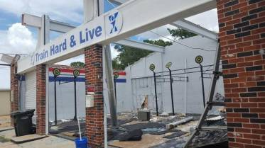 A tornado late Friday took the roof off the popular Singing River CrossFit at the corner of Ingalls Avenue and Market Street. Karen Nelson klnelson@sunherald